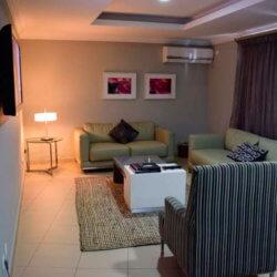 Hotel Milenio room lounge area